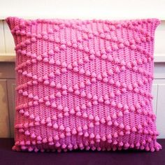 Crochet cushion handmade by Blossom Bazaar. Popcorn / bobble stitch in pink.