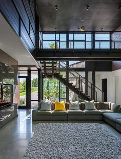 The double-height living area brings more natural light into the center of the house and creates an overall sense of openness