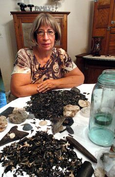 Linda Funk is shown with some of the fossils she's collected on The Sands beach in Port Royal and at Hunting Island State Park.   Jonathan Dyer/The Beaufort Gazette