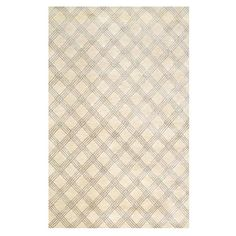 Anchor your living room seating group or define space in the den with this New Zealand wool and art silk rug, showcasing a plaid print.