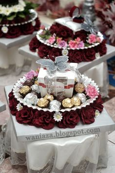 A bed of artificial roses placed under the rim adds a burst of color to these pedestal trays