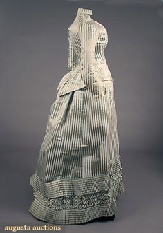 1880 Dress  Culture: French  Alternating stripes of sky blue satin & white faille: skirt w/ pleated trim, day jacket, capped sleeve ballgown bodice w/ lace flounce, ballgown bodice's petersham label stamped gold on white moire.