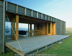 Scandinavian Retreat: Another Kiwi summer house - lower the wall, this is such a cool idea.