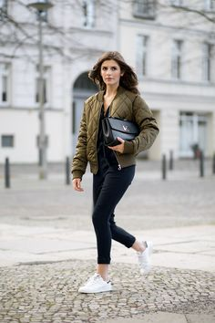 Quilted bombers are in this season! Valerie Husemann wears this army green bomber with a black plunge neck jumpsuit, creating a glamorous yet individual style which you should copy! Jacket: Noisy May, Jumpsuit: Zara, Shoes: Adidas, Bag: Mint & Berry.