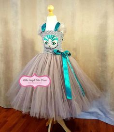 Check out this item in my Etsy shop https://www.etsy.com/uk/listing/538623248/cheshire-cat-dress-handmade-tutu-dress