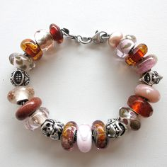 30 Day Challenge 2015 - Day 5 Trollbeads Bracelet design by Cathy of Tartooful The coppery translucence with the pale pinks is beautiful in this bracelet.