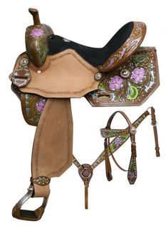 Double T  barrel style saddle set with metallic painted floral tooling…