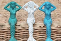Mermaid Figurines.  I think they are cast iron