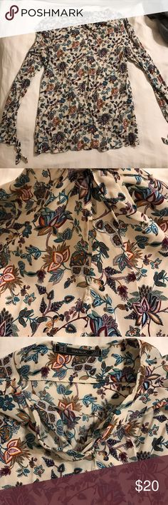 Zara Trafaluc shirt with keyhole cutout Wore this shirt twice. Fits great, unfortunately I don't have any occasions to wear it too. Viscose material, made in Morocco. Price negotiable, make an offer Zara Tops Blouses