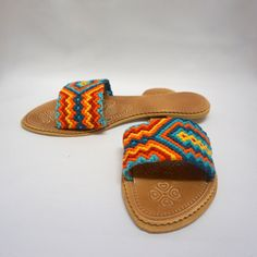 Give your feet a unique & special look with our Colorful handwoven sandals. Featuring a multicolor design of Wayuu crochet patterns and boho-chic style, these stunning slip-on sandals become a must have accessory for your summer or spring wardrobe. Every sandal is hand-woven and assembled by Wayuu women, an indigenous community from La Guajira Colombia, so every pair is one of a kind. Perfect for a casual day, as a beach/poolside accessory or as a compliment to your Yoga/Pilates outfit… Shoes Flats Sandals, Cute Sandals, Flat Sandals, Slide Sandals, Boho Fashion Summer, Surfer, Crochet Shoes, Womens Slippers, New Shoes