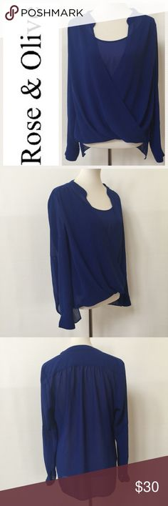 """Rose & Olive Royal Blue Blouse EUC.  Lightweight, semi sheer fabric. Sleeves may be worn either down, or roll tab sleeve option. High/low hem. Flattering draping to front. Measurements are as follows, and approximate, taken while garment was laying flat. Underarm to underarm:  20"""" Shoulder to hem:  22""""-27"""". Logo is Internet stock photo, all other photos are of actual blouse. Rose & Olive Tops Blouses"""