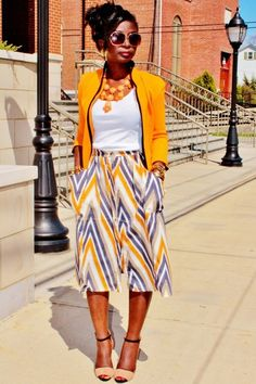 Ok.. Orange, you sold me... I love the combo of the statement necklace, the wife beater and the patterned skirt... I can see myself in this!