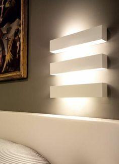 une jolie decoration avec eclairage indirect mural pour les murs gris
