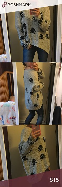 Super comfy oversized skull sweater Beige color pullover sweater with black skull print. Super soft oversized lazy day sweater. In excellent condition. No pilling or pulls. The tag reads size S/M. Good fit for anyone whose a size 4/6, but could fit bigger sizes too. Sweaters