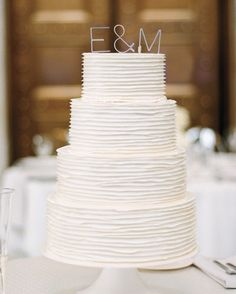 Aluminum letters by Gauge NYC topped the buttercream-frosted vanilla-and-strawberry cake.