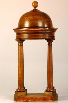 An antique architectural model called a Baldachin made of Walnut. Based of Michelangelo's similar model for St. Peter's in Rome, but with some noted differences, particularly in the placement of the pillars.