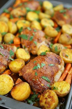 Garlic Ranch Roasted Chicken and Veggies - Super crisp, tender roasted chicken thighs with potatoes and carrots makes an easy one-pan weeknight meal! thecomfortofcooking.com