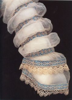 1868 dress sleeve detail - puffs of linen lawn interspersed with bands of silk satin and lace, Maltese-style bobbin lace.