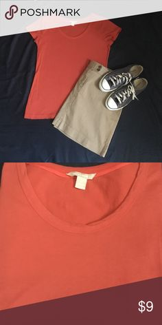 Banana Republic City Tee Quite possibly the best tee ever. Soft, perfect fit, great color.  Scoop neck and hits at the hip. Under a blazer? Yes. With a skirt? Sure. Shorts or jeans? Absolutely.  Selling multiple colors.  Color is like a brick red. Skirt and shoes for sale in separate listings. Banana Republic Tops Tees - Short Sleeve
