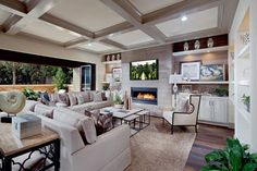 Luxurious living room with landscape view, long fireplace, and lots of space. Great for entertaining guests! #newhome #green #luxury