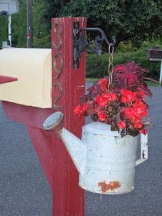 Nothing beats an old watering can!~~~~Cute idea for dressing up the mailbox.if ours wasn't so far from the house and people didn't like to beat our mailbox. Garden Junk, Garden Tools, Mailbox Makeover, Mailbox Landscaping, Mulch Landscaping, Container Flowers, Yard Art, Garden Projects, Container Gardening
