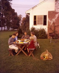 """Our new traveling exhibit with @sitesexhibits explores the rise of the backyard as an outdoor living room in the years after World War II. More information about """"Patios, Pools, & the Invention of the American Backyard"""" here: http://bit.ly/1sN5Gyy #ArchivesMonth The Farnham family in their Mendham, New Jersey garden, c. 1960. Molly Adams, photographer. Smithsonian Institution, Archives of American Gardens, Smithsonian Institution."""