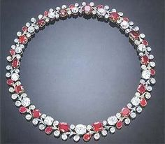 """This beautiful ruby ​​necklace is from a parure originally owned by Marie Alexandrovna, the Duchess of Edinburgh and Saxe-Coburg Gotha. Only daughter of Tsar Alexandar II of Russia, Marie Alexandrovna was used to having the best of everything. Her jewelry collection was superb. This parure was created by Bolin and given in 1874, the year of her marriage to Prince Alfred, the parure consisted of a lotus motif tiara, a devant de corsage and a sumptuous necklace. """