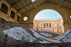 Elise Morin + Clemence Eliard [FR] - Waste Landscape - 65,000 CD's sewn together to cover 500 square meters.