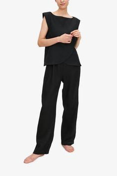A chic crossover front top made in our classic black linen paired with our lounge pants. This set is an example of what we do best - feminine, chic and luxurious sleepwear. Made in Canada. Into the Bedroom is the official online store for The Sleep Shirt. Cap Sleeve Top, Petite Tops, Sleep Shirt, Black Linen, Lounge Pants, Lingerie Sleepwear, Pajama Set, Black Pants, Black Tops