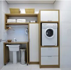 laundry: roll out shelf over sink...exactly what I need!