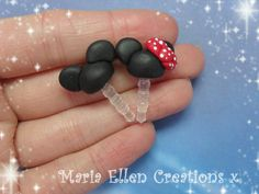 These are cute little Mickey and Minnie Mouse inspired dust plugs! :) They are ​​made using polymer clay and acrylic paint. They can be fully
