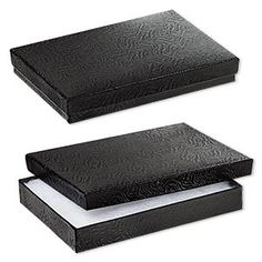 Box, paper, cotton-filled, black, 7-1/8 x 5-1/8 x 1-1/8 inches. Sold per pkg of 10. Find at Fire Mountain Gems and Beads.