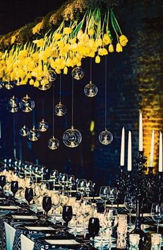 an upside-down centerpiece of yellow tulips and glass globes that hung above the head table.