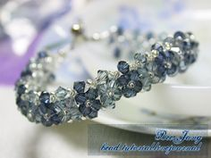 Tutorial : Crystal Bracelet #17 Level : Intermediate Equipment : - Swarovski Crystal 4 mm. - Seed bead - Jumprings - Clasp - Stopper - Bead tip - Pliers - Nylon thread no. 25 The colors I used here are Indian Sapphire and Montana. The seed bead is clear with silver lined. 1. Cut two nylon…