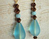 "Aqua colored Sea Glass Teardrops, Bronze diamond shape metal beads. 2"" long"