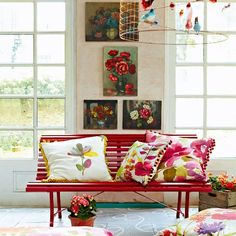 Create an artistic, painterly look in your consevatory with oversized florals patterns and plenty of statement artwork. Colourful furniture completes the look.