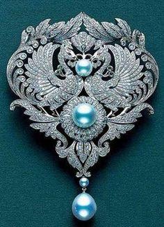 Diamond brooch with Mikimoto Pearls.
