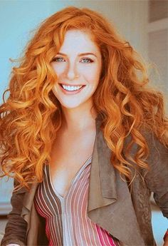 Canadian red headed actress Rachelle Lefevre with big waves More