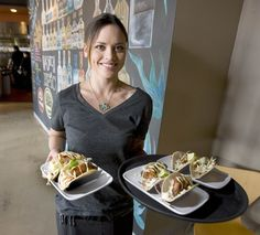 Stephanie Sims delivers fish tacos to diners at Taqueria 27 in Salt Lake City. (Paul Fraughton  |  The Salt Lake Tribune)
