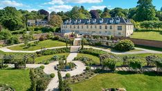 Robbie Williams's 72-Acre English Countryside Estate Lists for $9.2M – Robb Report Robbie Williams, Global Real Estate, Fairytale Cottage, Tudor House, Property For Sale, Property Prices, Chelsea Flower Show, Property Development, White Horses
