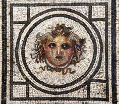 From Wikiwand: Gorgone au centre d'une mosaïque. Pompéi. Musée archéologique national de Naples