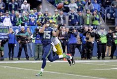 Seattle Seahawks' Jermaine Kearse catches the game-winning touchdown pass in front of the Green Bay Packers' Tramon Williams during overtime on Jan. 18 in Seattle.