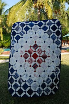 "Dad's quilt. Made with 3 charm packs of The Hamptons, plus 3 yards of the sailboat blueprint fabric on the back. finished size 73"" x 55"". Corners are chamfered."
