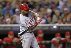 Los Angeles Angels' Alberto Callaspo hits a single off Minnesota Twins pitcher Glen Perkins that scores Angels' Peter Bourjos during the ninth inning of their American League MLB baseball game at Target Field in Minneapolis, May 7, 2012.