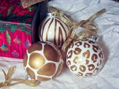 Hand Painted Gold and White Animal Print Ornaments. $20.00, via Etsy.