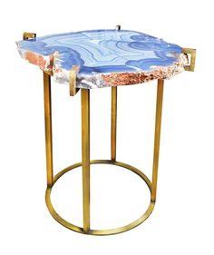 some semiprecious stone top plus antique brass base table. matthew studios new york