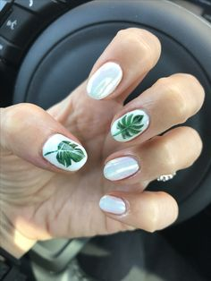 Korean gel nail design for vacation- white hologram chrome with tropical leaf