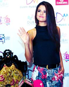 Selena Gomez is so stunning in this black tank and adorable floral printed pants.