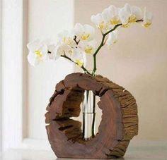 Imagen de http://static.ellahoy.es/ellahoy/fotogallery/625X0/211825/centro-de-mesa-para-boda-creado-con-madera.jpg.