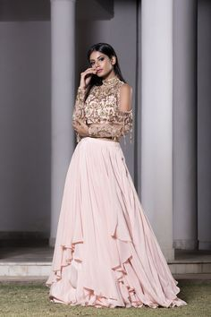DHEERU AND NITIKA eaturing a rose pink cold shoulder blouse in crepe base with hand embroidery and tassel detailing. It is paired with a matching layered lehenga. Designer Bridal Lehenga, Bridal Lehenga Choli, Lehenga Wedding, Desi Wedding, Lehenga Style, Red Lehenga, Bollywood Lehenga, Anarkali, Indian Dresses